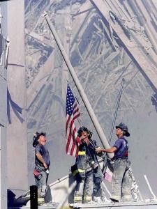 firemen-raise-flag-9-11